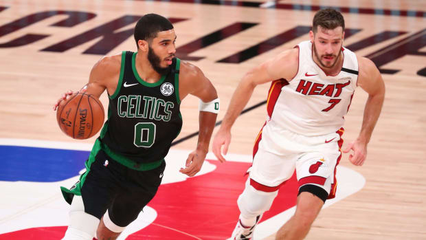 Boston Celtics forward Jayson Tatum (0) moves the ball against Miami Heat guard Goran Dragic (7) during the second half in game five of the Eastern Conference Finals of the 2020 NBA Playoffs at Advent...