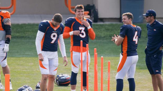 Denver Broncos quarterback Drew Lock (3) and quarterback Jeff Driskel (9) and quarterback Brett Rypien (4) during training camp at the UCHealth Training Center.