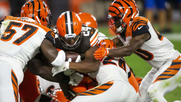 Sep 17, 2020; Cleveland, Ohio, USA; Cleveland Browns running back Nick Chubb (24) gets stopped at the 1-yard line by Cincinnati Bengals linebacker Germaine Pratt (57) and strong safety Vonn Bell (24) during the third quarter at FirstEnergy Stadium. Mandatory Credit: Scott Galvin-USA TODAY Sports