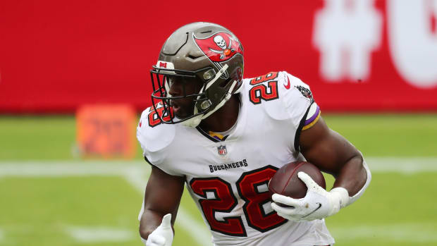 Tampa Bay Buccaneers running back Leonard Fournette (28) runs the ball against the Carolina Panthers during the second quarter at Raymond James Stadium.