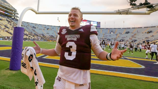 Mississippi State QB KJ Costello is all smiles after a win over LSU
