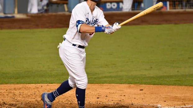 Sep 23, 2020; Los Angeles, California, USA; Los Angeles Dodgers center fielder Cody Bellinger (35) watches his solo homer clear the fence in the seventh inning against the Oakland Athletics at Dodger Stadium. Mandatory Credit: Robert Hanashiro-USA TODAY Sports