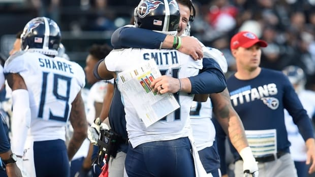 Tennessee Titans head coach Mike Vrabel hugs tight end Jonnu Smith (81) after his touchdown during the fourth quarter at Oakland-Alameda County Coliseum Sunday, Dec. 8, 2019 in Oakland, Ca.
