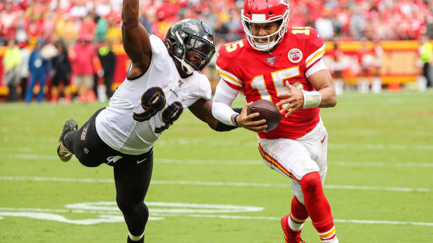 Sep 22, 2019; Kansas City, MO, USA; Kansas City Chiefs quarterback Patrick Mahomes (15) runs against Baltimore Ravens outside linebacker Matt Judon (99) during the second half at Arrowhead Stadium. Mandatory Credit: Jay Biggerstaff-USA TODAY Sports