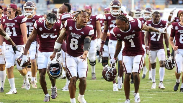 Mississippi State Bulldogs running back Kylin Hill (8) celebrates with cornerback Martin Emerson (1) following a 44-34 win against the LSU Tigers at Tiger Stadium.