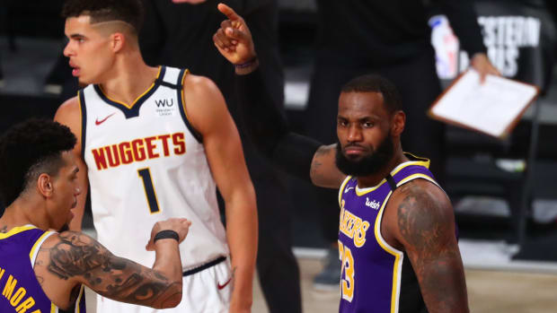 Los Angeles Lakers forward LeBron James (23) reacts against the Denver Nuggets during the fourth quarter in game five of the Western Conference Finals of the 2020 NBA Playoffs at AdventHealth Arena.