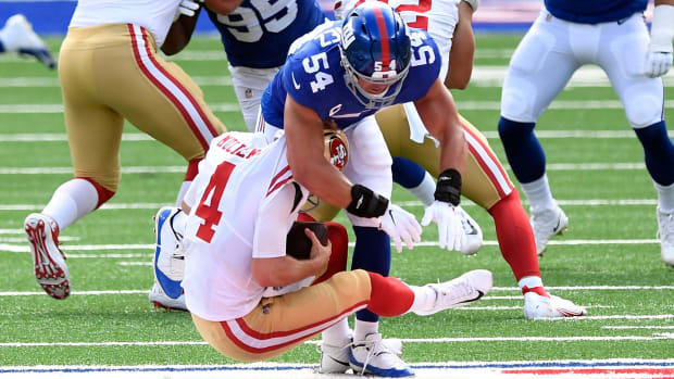 New York Giants linebacker Blake Martinez (54) sacks San Francisco 49ers quarterback Nick Mullens (4) in the first quarter. The Giants face the 49ers in an NFL game at MetLife Stadium on Sunday, Sept. 27, 2020, in East Rutherford. Giants 49ers