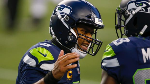 Seattle Seahawks quarterback Russell Wilson (3) reacts after throwing a touchdown pass against the New England Patriots during the third quarter at CenturyLink Field.