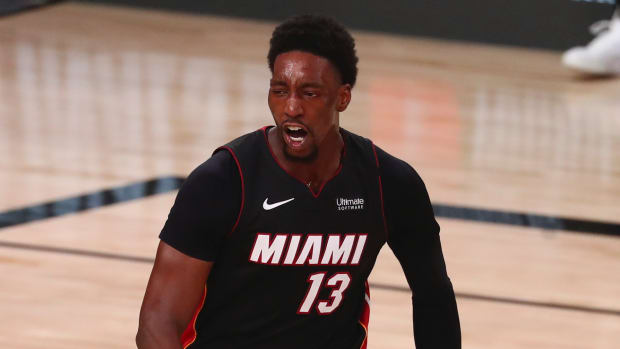 Miami Heat forward Bam Adebayo (13) flexes after dunking the ball