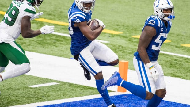 Indianapolis Colts cornerback T.J. Carrie scores on an interception return in Sunday's 36-7 home win over the N.Y. Jets.