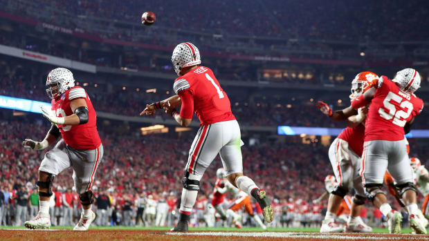 Ohio State QB Justin Fields throws during last year's playoff