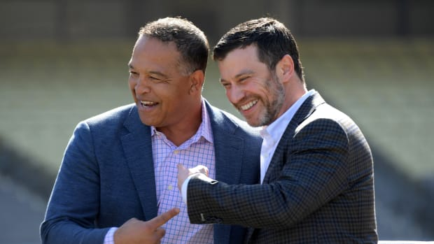 Feb 12, 2020; Los Angeles, California, USA; Los Angeles Dodgers manager Dave Roberts (left) and president of baseball operations Andrew Friedman react during a press conference at Dodger Stadium. Mandatory Credit: Kirby Lee-USA TODAY Sports