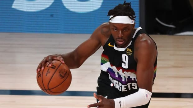 Denver Nuggets forward Jerami Grant dribbles upcourt against the Los Angeles Lakers during the Western Conference Finals of the 2020 NBA Playoffs at AdventHealth Arena.