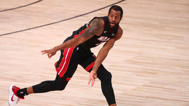 Miami Heat guard Andre Iguodala reacts after making a three pointer