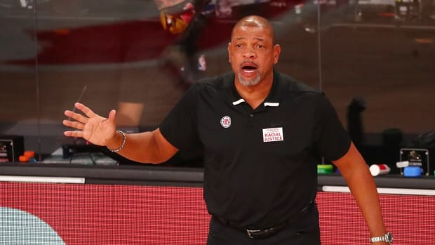 Former Los Angeles Clippers coach Doc Rivers reacts against the Dallas Mavericks during the first round of the 2020 NBA Playoffs at AdventHealth Arena.