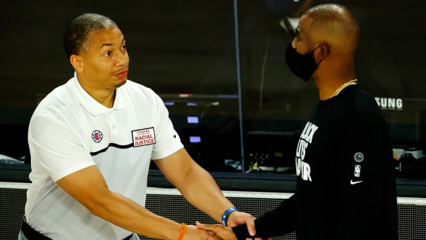 Los Angeles Clippers assistant coach Tyronn Lue shakes hands with Oklahoma City point guard Chris Paul prior to a game at The Field House at ESPN Wide World of Sports Complex.
