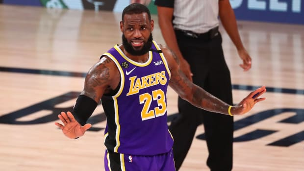 Los Angeles Lakers forward LeBron James reacts against the Denver Nuggets during the fourth quarter in game five of the Western Conference Finals
