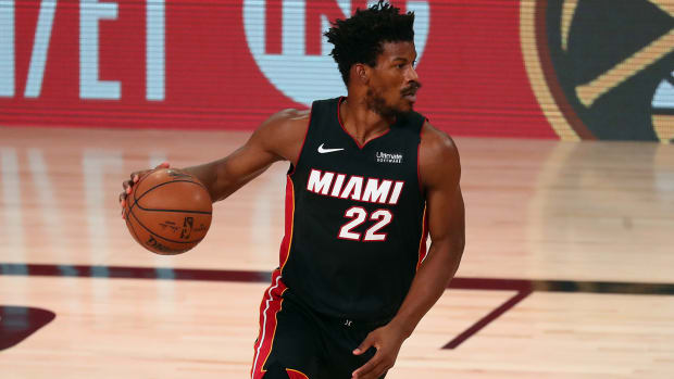 Miami Heat forward Jimmy Butler controls the ball against the Boston Celtics
