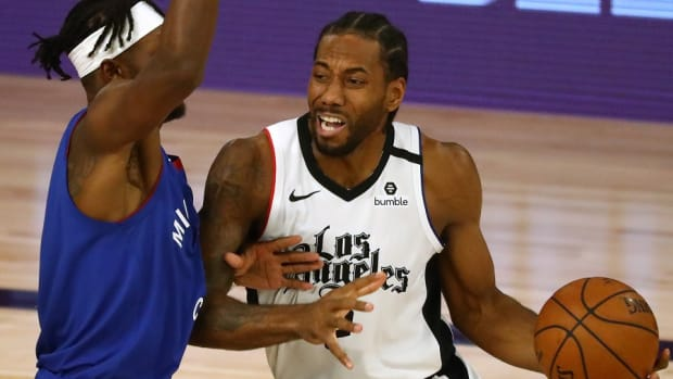 Los Angeles Clippers forward Kawhi Leonard drives against Denver Nuggets forward Jerami Grant during the second round of the 2020 NBA Playoffs at ESPN Wide World of Sports Complex.