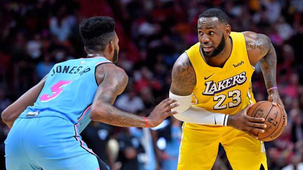 Miami Heat forward Derrick Jones Jr. guards Los Angeles Lakers forward LeBron James