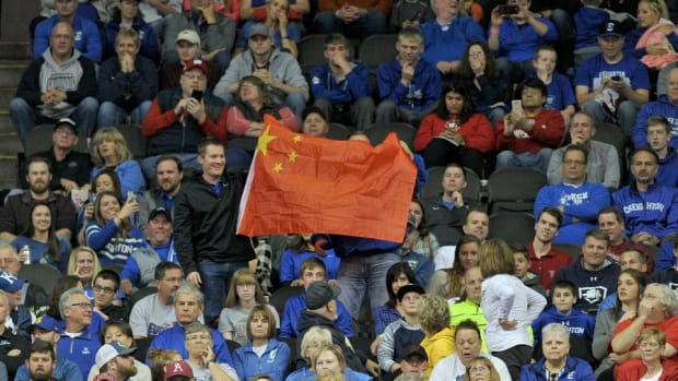 Fans hold up a Chinese flag during the first half of the game between the UCLA Bruins and Creighton Bluejays at Sprint Center.