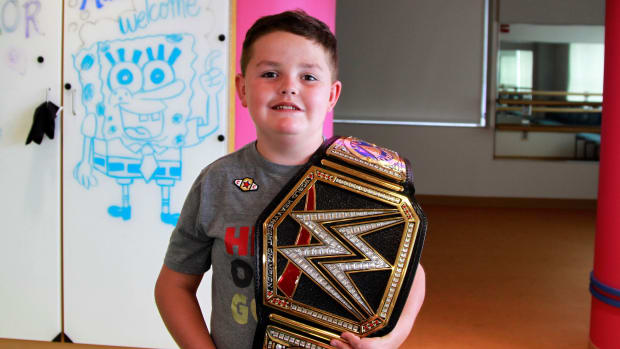 WWE fan Jimmy Spagnolo poses with a championship belt