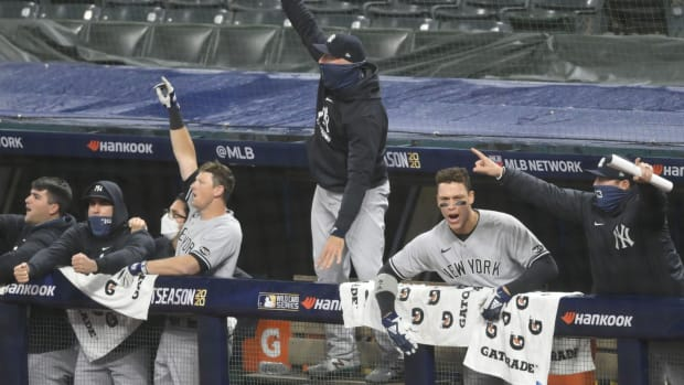 Yankees dugout celebrating in Wild Card Game 2 in Cleveland