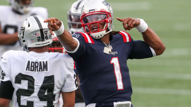 Sep 27, 2020; Foxborough, Massachusetts, USA; New England Patriots quarterback Cam Newton (1) reacts after running for a first down during the second half against the Las Vegas Raiders at Gillette Stadium. Mandatory Credit: Paul Rutherford-USA TODAY Sports