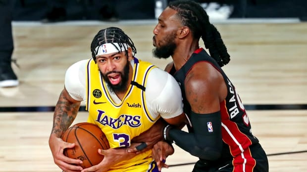 Los Angeles Lakers forward Anthony Davis drives to the basket against Miami Heat forward Jae Crowder during the 2020 NBA Finals at AdventHealth Arena.