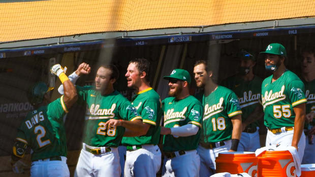A's dugout fired up after Khris Davis' homer in Game 2 Wednesday.