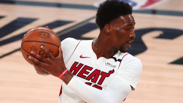 Miami Heat forward Bam Adebayo controls the ball against the Boston Celtics in the Eastern Conference Finals of the 2020 NBA Playoffs at AdventHealth Arena.