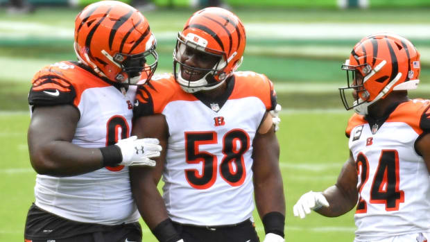 Sep 27, 2020; Philadelphia, Pennsylvania, USA; Cincinnati Bengals defensive end Carl Lawson (58) celebrates his sack with nose tackle D.J. Reader (98) against the Philadelphia Eagles during the first quarter at Lincoln Financial Field. Mandatory Credit: Eric Hartline-USA TODAY Sports