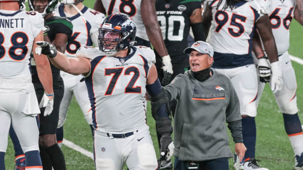 Denver Broncos head coach Vic Fangio reacts with offensive tackle Garett Bolles (72) after their game against the New York Jets at MetLife Stadium.