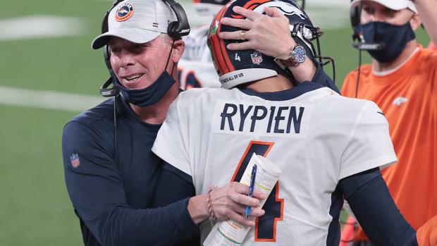 Denver Broncos offensive coordinator Pat Shurmur hugs quarterback Brett Rypien (4) after a touchdown pass during the first half against the New York Jets at MetLife Stadium.