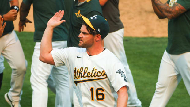 Liam Hendriks celebrates A's wild card-clinching win