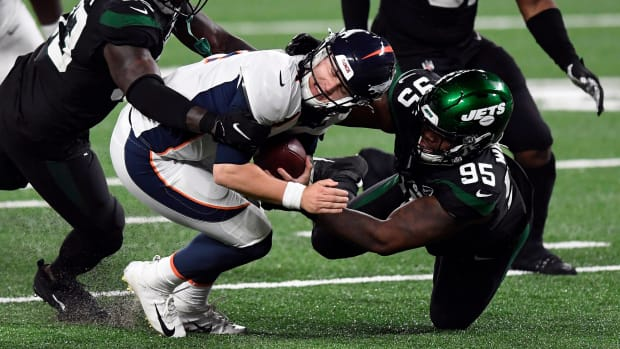 Broncos QB Brett Rypien is sacked against the Jets