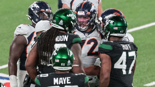 New Jersey, USA; Denver Broncos offensive tackle Garett Bolles (72) argues with New York Jets nose tackle Steve McLendon (99) during the second half at MetLife Stadium.