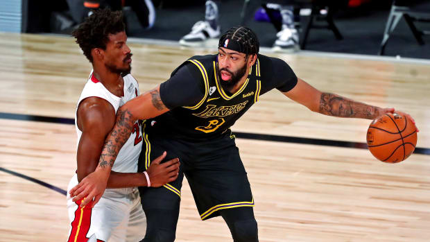 Los Angeles Lakers forward Anthony Davis (3) handles the ball against Miami Heat forward Jimmy Butler (22) during the first quarter in game two of the 2020 NBA Finals at AdventHealth Arena.