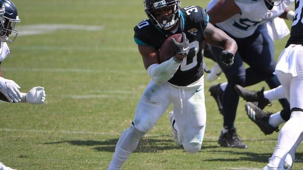 Sep 20, 2020; Nashville, Tennessee, USA; Jacksonville Jaguars running back James Robinson (30) runs the ball at Nissan Stadium. Mandatory Credit: Steve Roberts-USA TODAY Sports