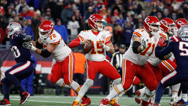 Dec 8, 2019; Foxborough, MA, USA; Kansas City Chiefs quarterback Patrick Mahomes (15) looks to pass against the New England Patriots during the first quarter at Gillette Stadium. Mandatory Credit: Winslow Townson-USA TODAY Sports