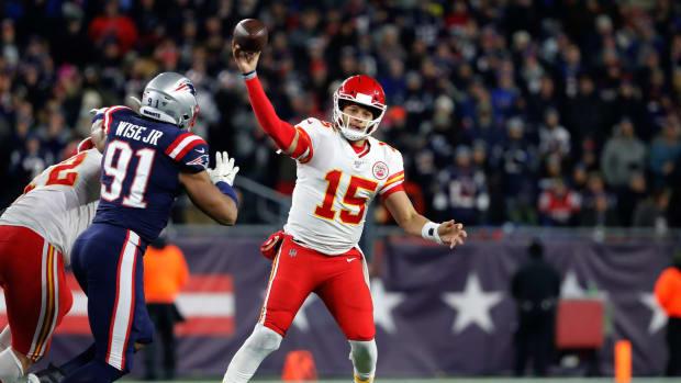 Dec 8, 2019; Foxborough, MA, USA; Kansas City Chiefs quarterback Patrick Mahomes (15) passes against the New England Patriots during the first quarter at Gillette Stadium. Mandatory Credit: Winslow Townson-USA TODAY Sports