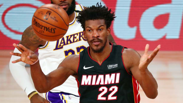 Miami Heat forward Jimmy Butler (22) passes the ball against the Los Angeles Lakers during the third quarter of game three of the 2020 NBA Finals at AdventHealth Arena.