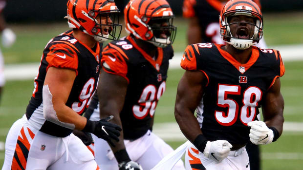 Cincinnati Bengals defensive end Carl Lawson (58), far right, celebrates and runs off the field after sacking Jacksonville Jaguars quarterback Gardner Minshew (15) (not pictured) in the third quarter of a Week 4 NFL football game, Sunday, Oct. 4, 2020, at Paul Brown Stadium in Cincinnati. The Cincinnati Bengals won 33-25. Jacksonville Jaguars At Cincinnati Bengals Oct 4