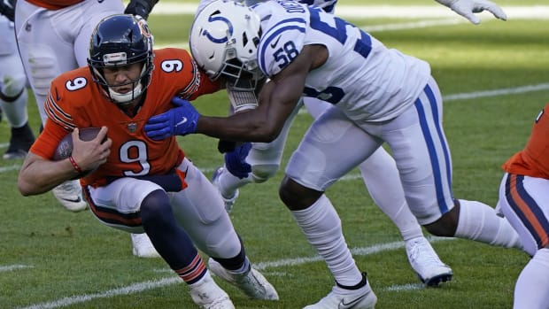 Indianapolis Colts linebacker Bobby Okereke (58) tackles Chicago Bears quarterback Nick Foles (9) during Sunday's 19-11 Colts road win at Soldier Field.