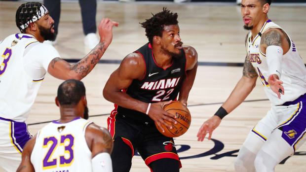 Miami Heat forward Jimmy Butler looks to shoot against Los Angeles Lakers guard Danny Green