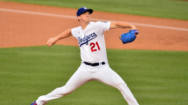 August 21, 2020; Los Angeles, California, USA; Los Angeles Dodgers starting pitcher Walker Buehler (21) throws against the Colorado Rockies during the first inning against the Colorado Rockies at Dodger Stadium. Mandatory Credit: Gary A. Vasquez-USA TODAY Sports