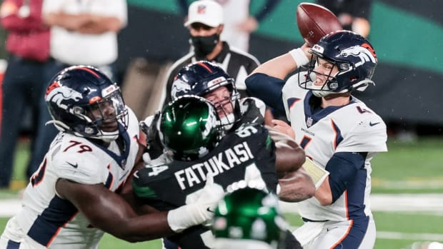 Denver Broncos quarterback Brett Rypien (4) throws the ball as New York Jets defensive tackle Foley Fatukasi (94) defends during the second half at MetLife Stadium.