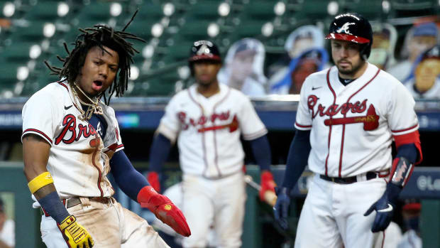Oct 6, 2020; Houston, Texas, USA; Atlanta Braves center fielder Ronald Acuna Jr. (13) celebrates after scoring a run in the 3rd inning against the Miami Marlins during game one of the 2020 NLDS at Minute Maid Park.