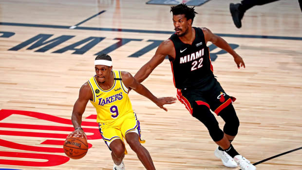 Los Angeles Lakers guard Rajon Rondo handles the ball against Miami Heat forward Jimmy Butler in the NBA Finals