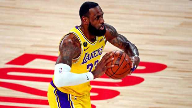 Los Angeles Lakers forward LeBron James passes the ball in the NBA Finals